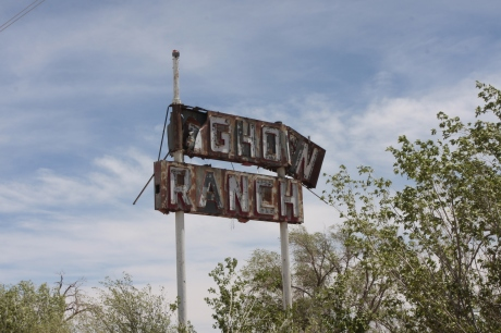 Old Longhorn sign that will not last much longer.