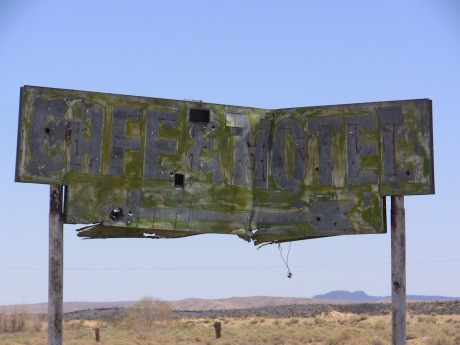 An old sign along the road.