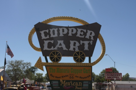 Old Copper cart Mexican food sign.  Still in business.
