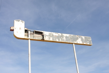 Abandoned Whiting Bros. Gas sign.